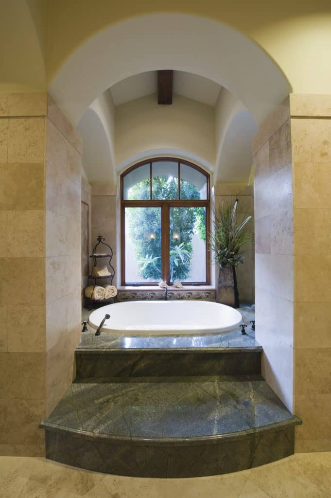 This bathtub nook is the perfect addition to any luxury bathroom. The wall tiles and windows add so much to this area.
