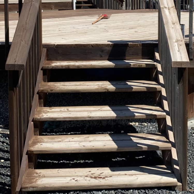 before and after restaining deck photo