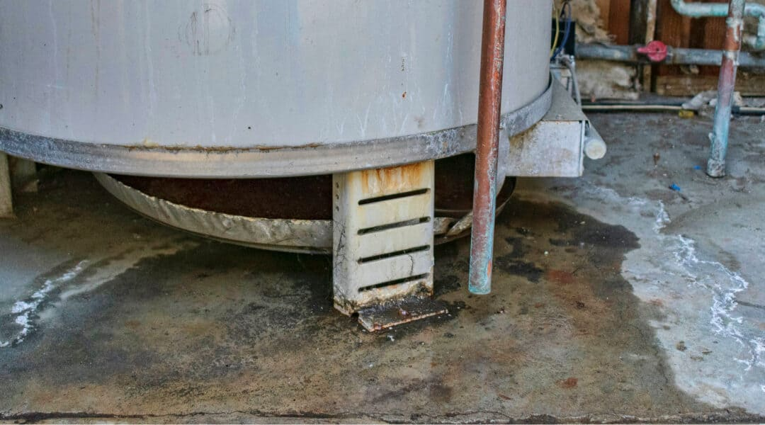 Hot Water Tank Leaking From Bottom? Do This Now!