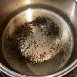 Food scraped off burnt pot
